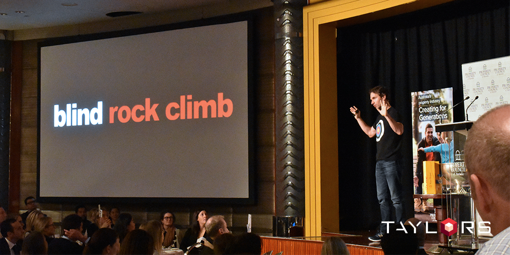 Todd Sampson addresses the audience speaking of his own challenges and the power of the brain